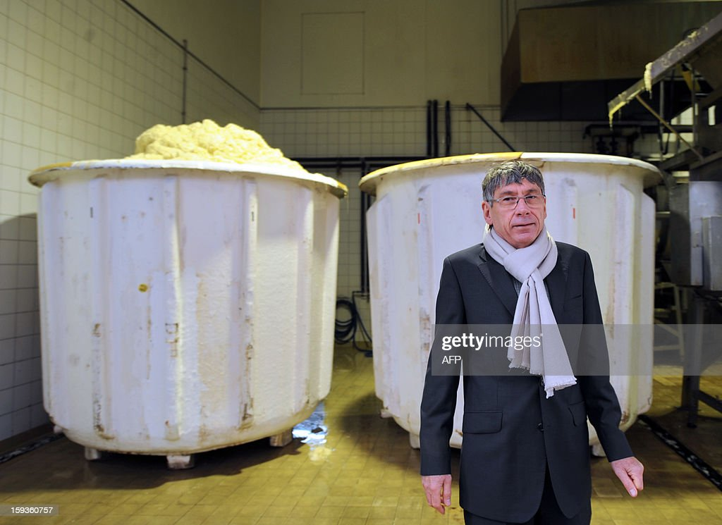 Gerald Christ, President of Christ SAS poses in front of tanks filled with fermented cabbage at the sauerkraut factory of Charles Christ, a French firm specialized in canned cooked dishes and condiments, on January 11, 2013 at Connerre, western France.