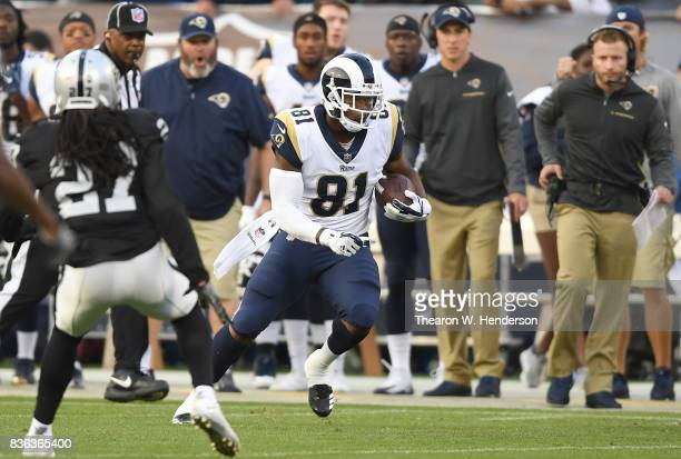 Gerald Everett of the Los Angeles Rams runs with the ball after catching a pass against the Oakland Raiders during the first quarter of their...