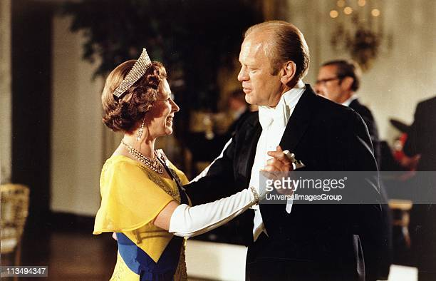 UNSPECIFIED Gerald Ford 38th President of the United States 19741977 dancing with Queen Elizabeth II at the ball at the White House Washington during...