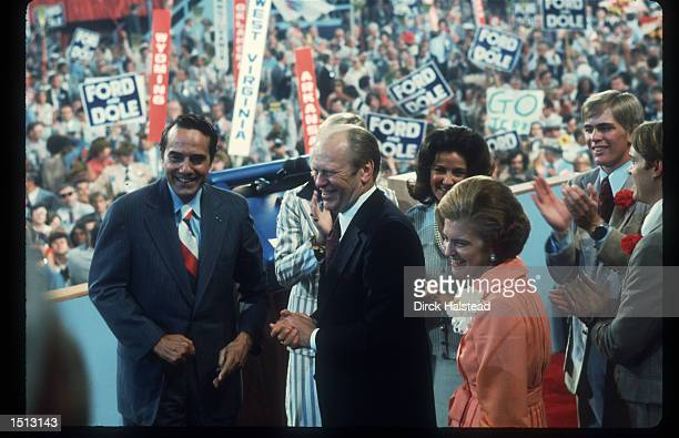 Gerald Ford is flanked by his wife Elizabeth and Senator Bob Dole of Kansas August 19 1976 at the Republican National Convention in Kansas City...