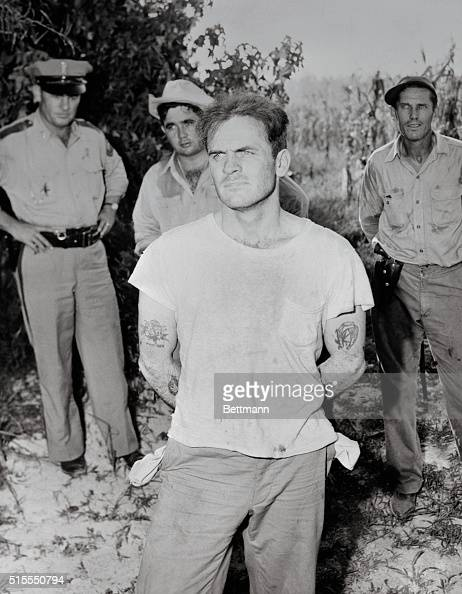 Gerald Gallego stands at the edge of a parched cornfield after bloodhounds sniffed him out from behind a tree to end Mississippi's greatest manhunt