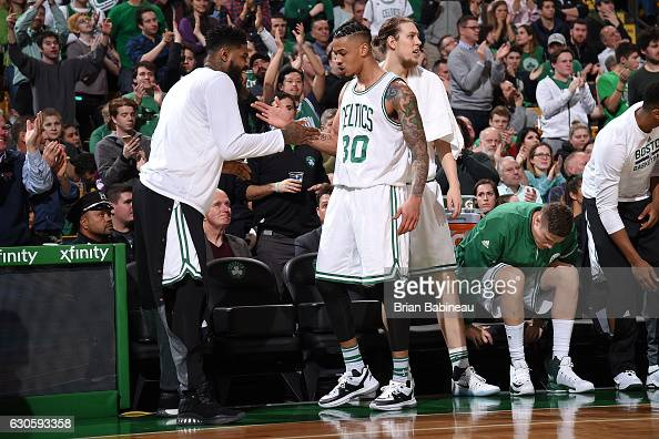Gerald Green and Amir Johnson of the Boston Celtics high five each other during the game against the Memphis Grizzlies on December 27 2016 at TD...