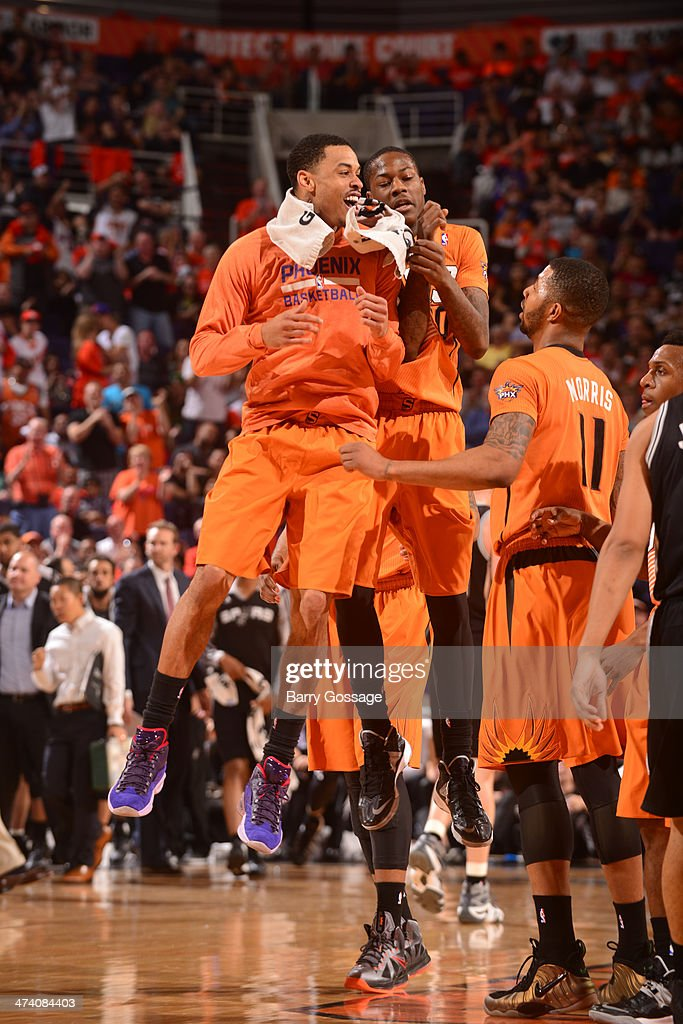 Gerald Green #14 and Archie Goodwin #20 of the Phoenix Suns celebrate during the game against the San Antonio Spurs on February 21, 2014 at U.S. Airways Center in Phoenix, Arizona.