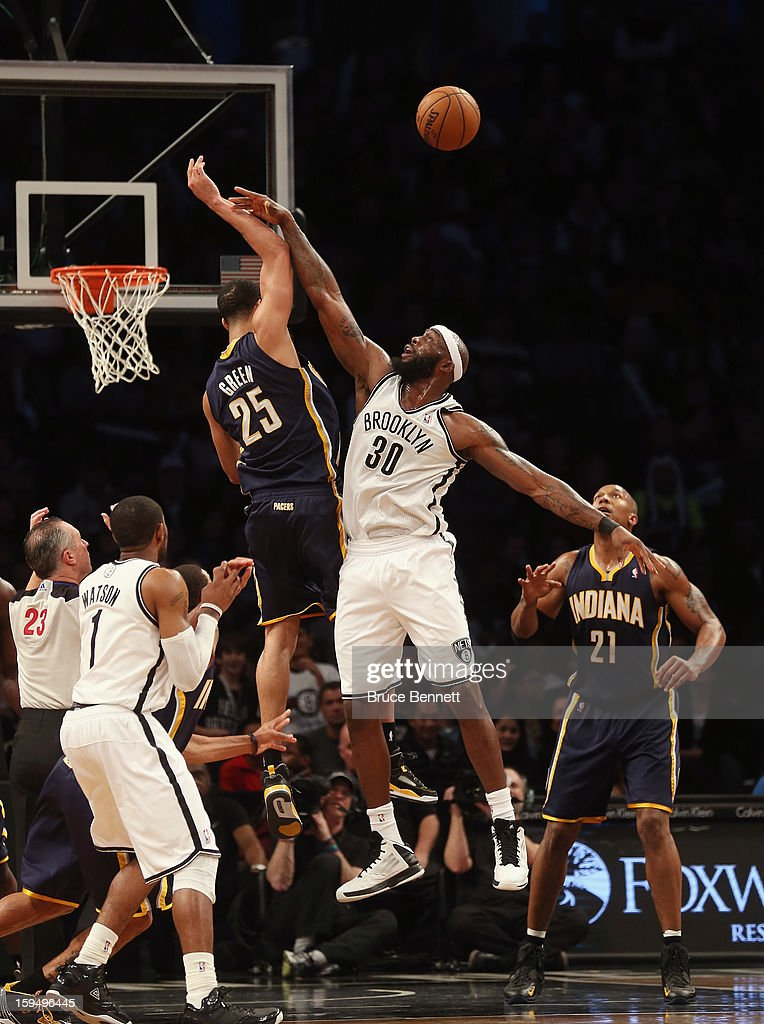 Gerald Green #25 of the Indiana Pacers blocks a shot by Reggie Evans #30 of the Brooklyn Nets at the Barclays Center on January 13, 2013 in New York City.