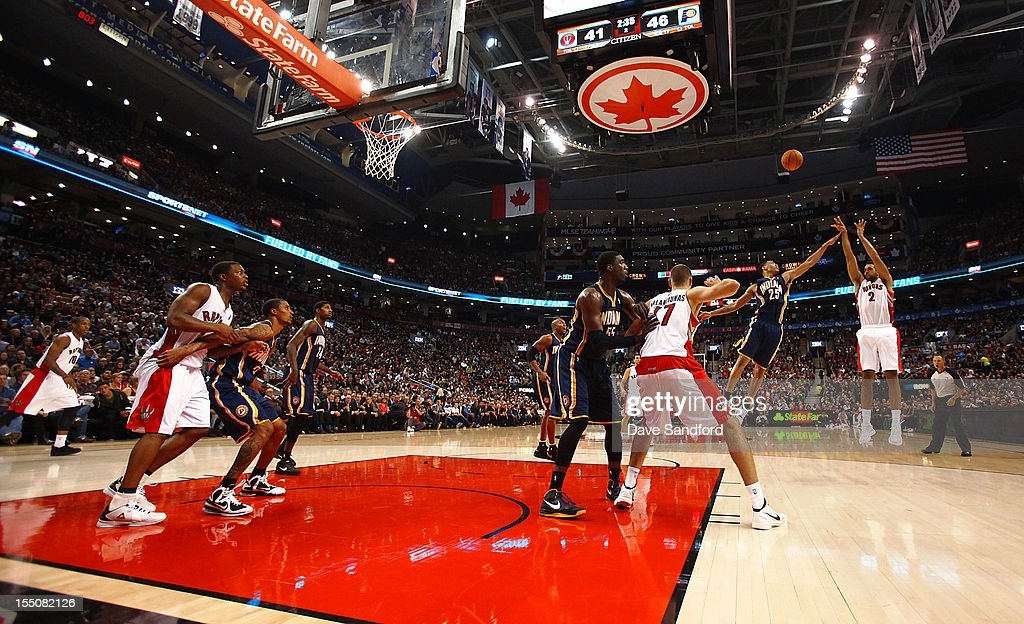 <a gi-track='captionPersonalityLinkClicked' href=/galleries/search?phrase=Gerald+Green&family=editorial&specificpeople=644655 ng-click='$event.stopPropagation()'>Gerald Green</a> #25 of the Indiana Pacers defends against <a gi-track='captionPersonalityLinkClicked' href=/galleries/search?phrase=Landry+Fields&family=editorial&specificpeople=4184645 ng-click='$event.stopPropagation()'>Landry Fields</a> #2 of the Toronto Raptors as he sinks a 3 point shot on October 31, 2012 at the Air Canada Centre in Toronto, Canada.