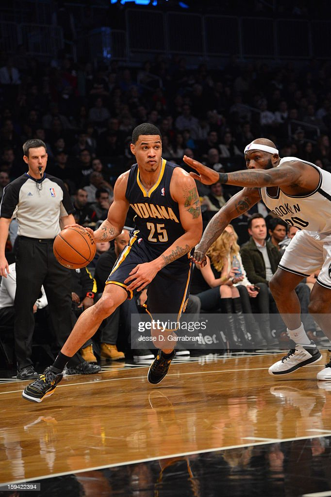 Gerald Green #25 of the Indiana Pacers dribbles to the basket against Reggie Evans #30 of the Brooklyn Nets during the game at the Barclays Center on January 13, 2013 in Brooklyn, New York.