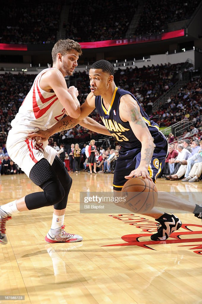 Gerald Green #25 of the Indiana Pacers drives against Chandler Parsons #25 of the Houston Rockets on March 27, 2013 at the Toyota Center in Houston, Texas.