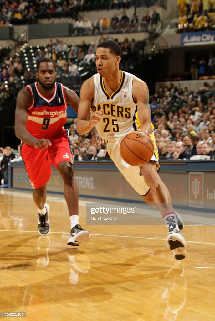<a gi-track='captionPersonalityLinkClicked' href=/galleries/search?phrase=Gerald+Green&family=editorial&specificpeople=644655 ng-click='$event.stopPropagation()'>Gerald Green</a> #25 of the Indiana Pacers drives against <a gi-track='captionPersonalityLinkClicked' href=/galleries/search?phrase=Martell+Webster&family=editorial&specificpeople=601785 ng-click='$event.stopPropagation()'>Martell Webster</a> #9 of the Washington Wizards during the game between the Indiana Pacers and the Washington Wizards on November 10, 2012 at Bankers Life Fieldhouse in Indianapolis, Indiana.