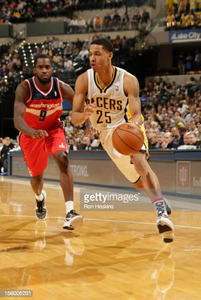 Gerald Green of the Indiana Pacers drives against Martell Webster of the Washington Wizards during the game between the Indiana Pacers and the...