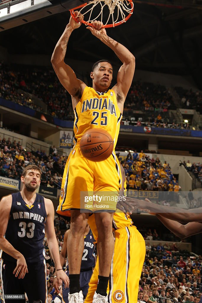 <a gi-track='captionPersonalityLinkClicked' href=/galleries/search?phrase=Gerald+Green&family=editorial&specificpeople=644655 ng-click='$event.stopPropagation()'>Gerald Green</a> #25 of the Indiana Pacers dunks the ball against the Memphis Grizzlies on December 31, 2012 at Bankers Life Fieldhouse in Indianapolis, Indiana.