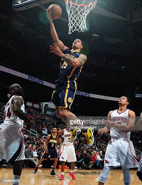 Gerald Green of the Indiana Pacers goes to the basket against Ivan Johnson of the Atlanta Hawks on December 29 2012 at Philips Arena in Atlanta...