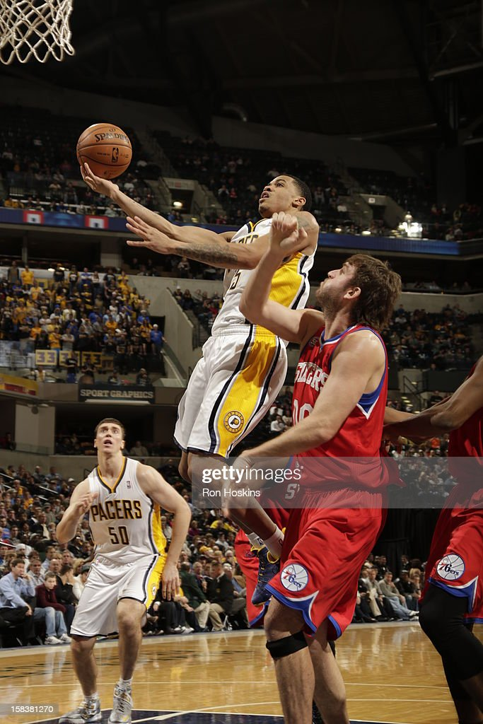 <a gi-track='captionPersonalityLinkClicked' href=/galleries/search?phrase=Gerald+Green&family=editorial&specificpeople=644655 ng-click='$event.stopPropagation()'>Gerald Green</a> #25 of the Indiana Pacers goes to the basket against <a gi-track='captionPersonalityLinkClicked' href=/galleries/search?phrase=Spencer+Hawes&family=editorial&specificpeople=3848319 ng-click='$event.stopPropagation()'>Spencer Hawes</a> #00 of the Philadelphia 76ers on December 14, 2012 at Bankers Life Fieldhouse in Indianapolis, Indiana.