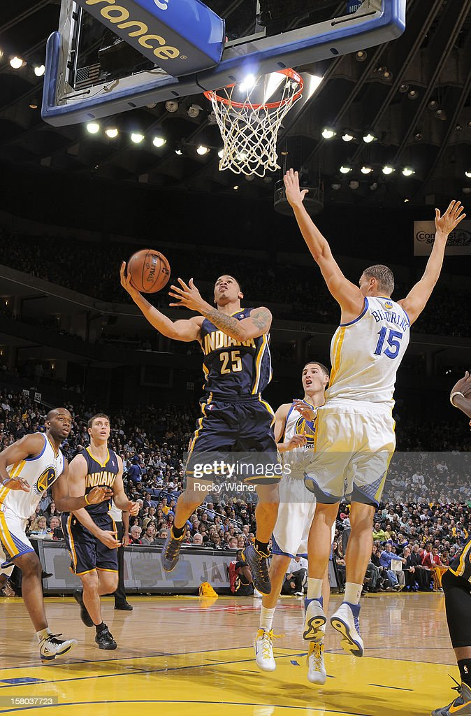 <a gi-track='captionPersonalityLinkClicked' href=/galleries/search?phrase=Gerald+Green&family=editorial&specificpeople=644655 ng-click='$event.stopPropagation()'>Gerald Green</a> #25 of the Indiana Pacers goes up for the shot against <a gi-track='captionPersonalityLinkClicked' href=/galleries/search?phrase=Andris+Biedrins&family=editorial&specificpeople=204473 ng-click='$event.stopPropagation()'>Andris Biedrins</a> #15 of the Golden State Warriors on December 1, 2012 at Oracle Arena in Oakland, California.