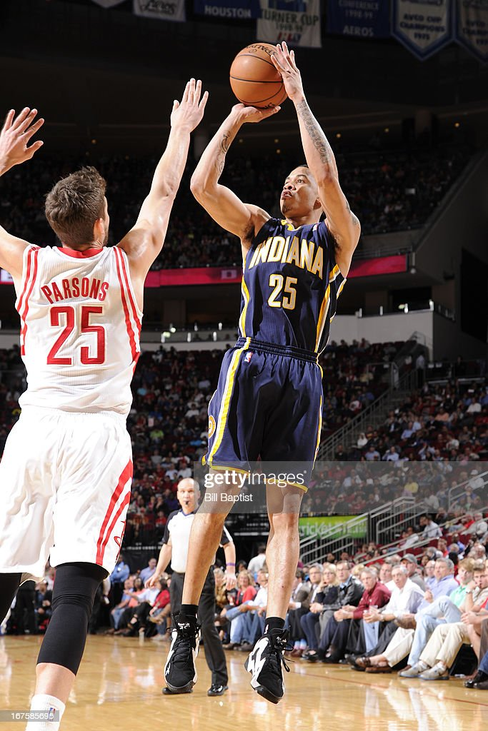<a gi-track='captionPersonalityLinkClicked' href=/galleries/search?phrase=Gerald+Green&family=editorial&specificpeople=644655 ng-click='$event.stopPropagation()'>Gerald Green</a> #25 of the Indiana Pacers shoots against <a gi-track='captionPersonalityLinkClicked' href=/galleries/search?phrase=Chandler+Parsons&family=editorial&specificpeople=4249869 ng-click='$event.stopPropagation()'>Chandler Parsons</a> #25 of the Houston Rockets on March 27, 2013 at the Toyota Center in Houston, Texas.