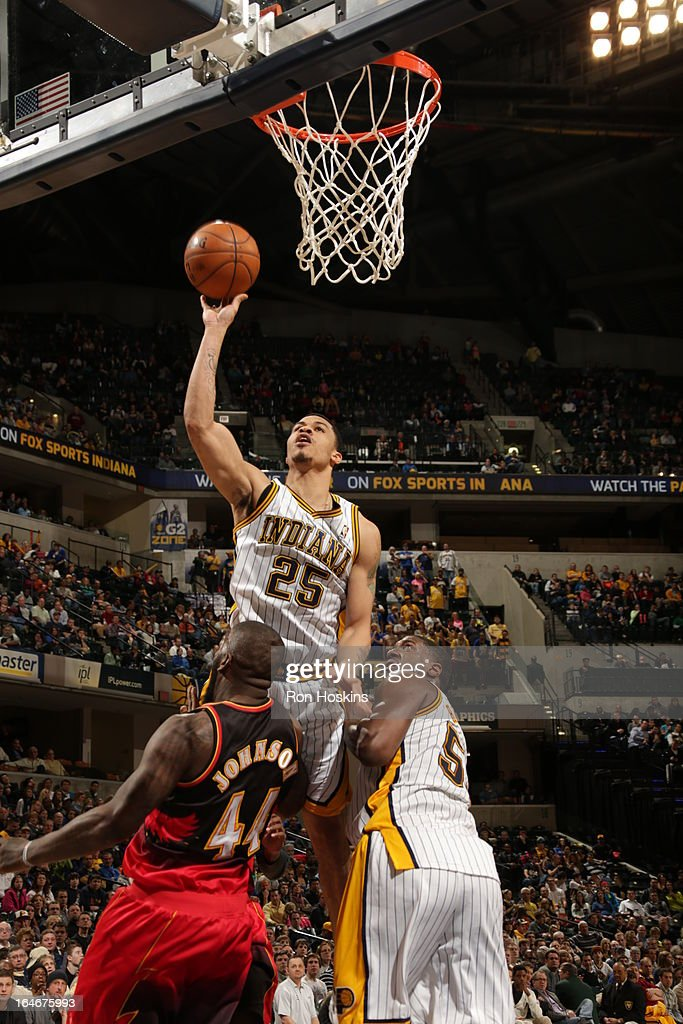 <a gi-track='captionPersonalityLinkClicked' href=/galleries/search?phrase=Gerald+Green&family=editorial&specificpeople=644655 ng-click='$event.stopPropagation()'>Gerald Green</a> #25 of the Indiana Pacers shoots against Ivan Johnson #44 of the Atlanta Hawks on March 25, 2013 at Bankers Life Fieldhouse in Indianapolis, Indiana.