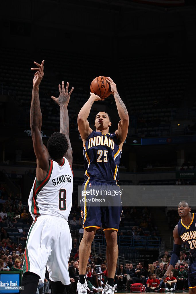 <a gi-track='captionPersonalityLinkClicked' href=/galleries/search?phrase=Gerald+Green&family=editorial&specificpeople=644655 ng-click='$event.stopPropagation()'>Gerald Green</a> #25 of the Indiana Pacers shoots against Larry Sanders #8 of the Milwaukee Bucks during the game on December 18, 2012 at the BMO Harris Bradley Center in Milwaukee, Wisconsin.