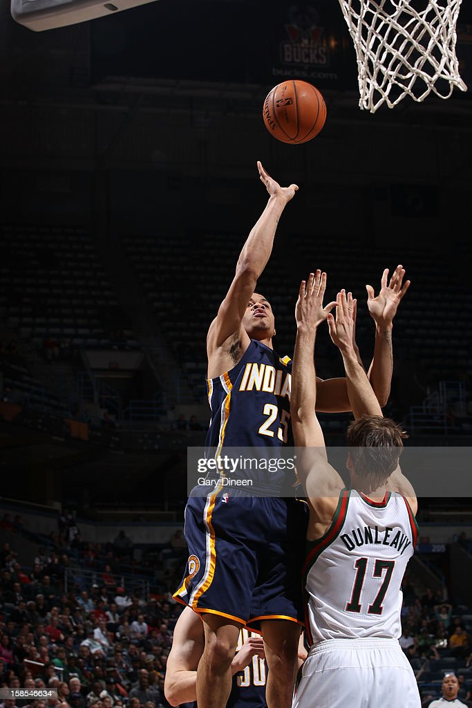 <a gi-track='captionPersonalityLinkClicked' href=/galleries/search?phrase=Gerald+Green&family=editorial&specificpeople=644655 ng-click='$event.stopPropagation()'>Gerald Green</a> #25 of the Indiana Pacers shoots against Mike Dunleavy #17 of the Milwaukee Bucks during the game on December 18, 2012 at the BMO Harris Bradley Center in Milwaukee, Wisconsin.
