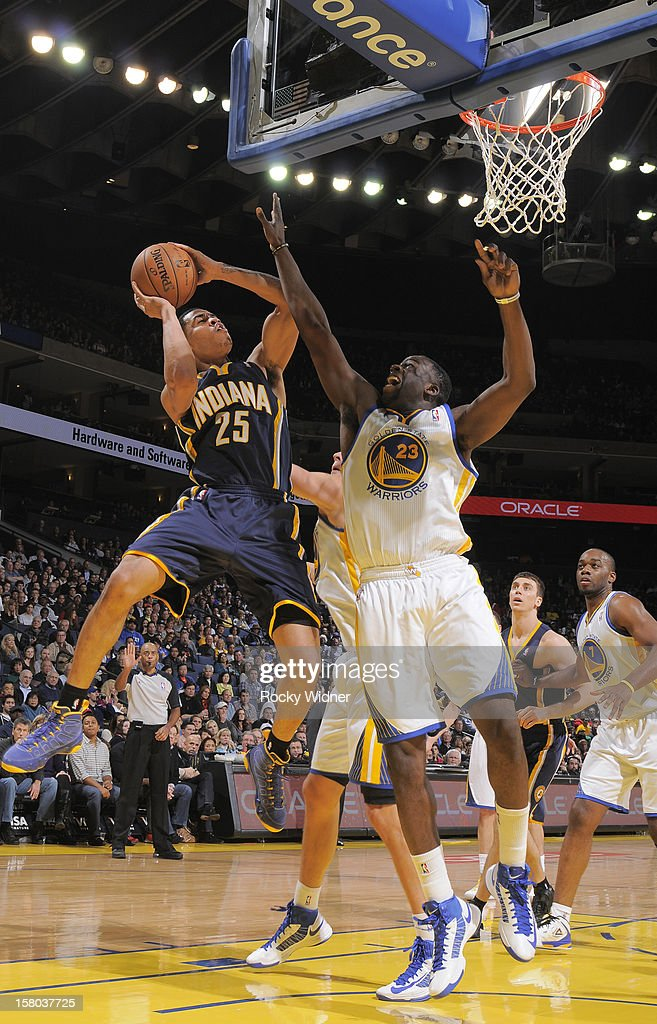 <a gi-track='captionPersonalityLinkClicked' href=/galleries/search?phrase=Gerald+Green&family=editorial&specificpeople=644655 ng-click='$event.stopPropagation()'>Gerald Green</a> #25 of the Indiana Pacers shoots over <a gi-track='captionPersonalityLinkClicked' href=/galleries/search?phrase=Draymond+Green&family=editorial&specificpeople=5628054 ng-click='$event.stopPropagation()'>Draymond Green</a> #23 of the Golden State Warriors on December 1, 2012 at Oracle Arena in Oakland, California.