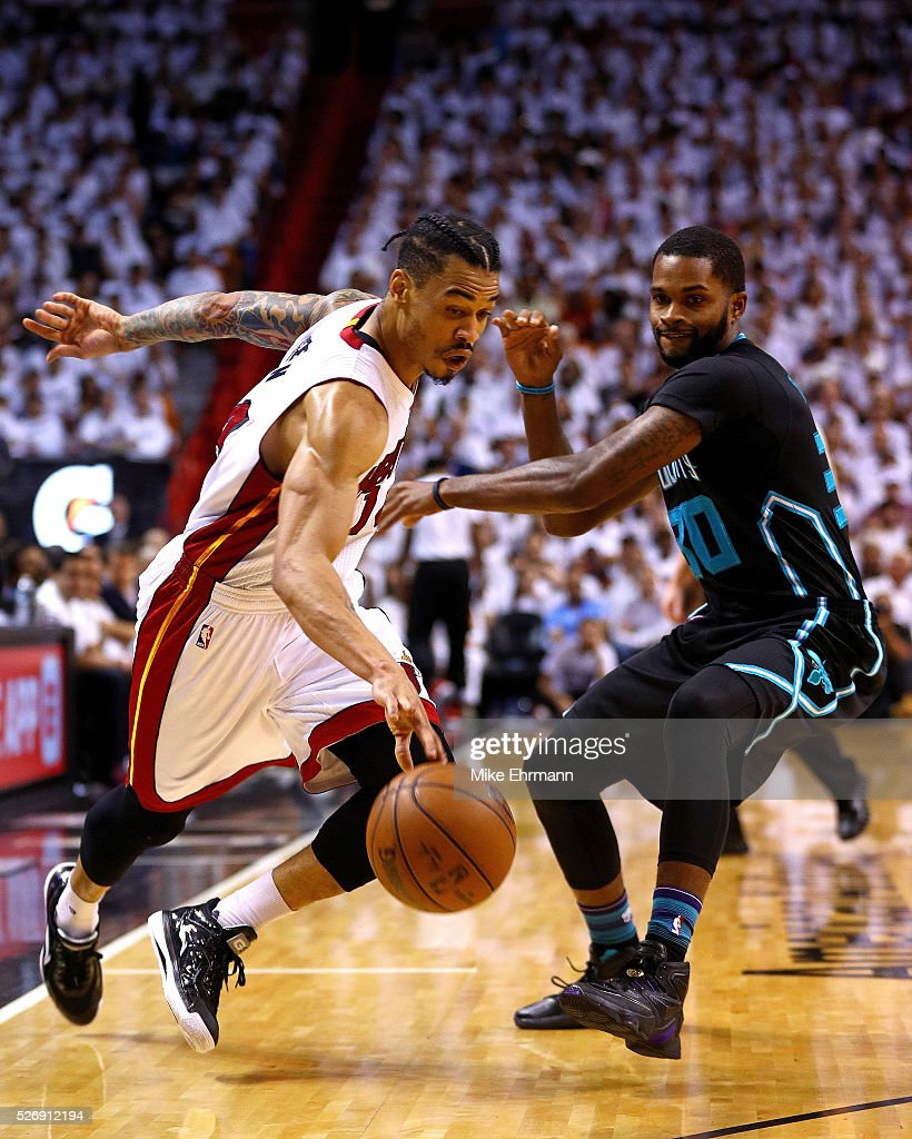 <a gi-track='captionPersonalityLinkClicked' href=/galleries/search?phrase=Gerald+Green&family=editorial&specificpeople=644655 ng-click='$event.stopPropagation()'>Gerald Green</a> #14 of the Miami Heat drives by <a gi-track='captionPersonalityLinkClicked' href=/galleries/search?phrase=Troy+Daniels+-+Basketball+Player&family=editorial&specificpeople=11489473 ng-click='$event.stopPropagation()'>Troy Daniels</a> #30 of the Charlotte Hornets during Game Seven of the Eastern Conference Quarterfinals of the 2016 NBA Playoffs at American Airlines Arena on May 1, 2016 in Miami, Florida.