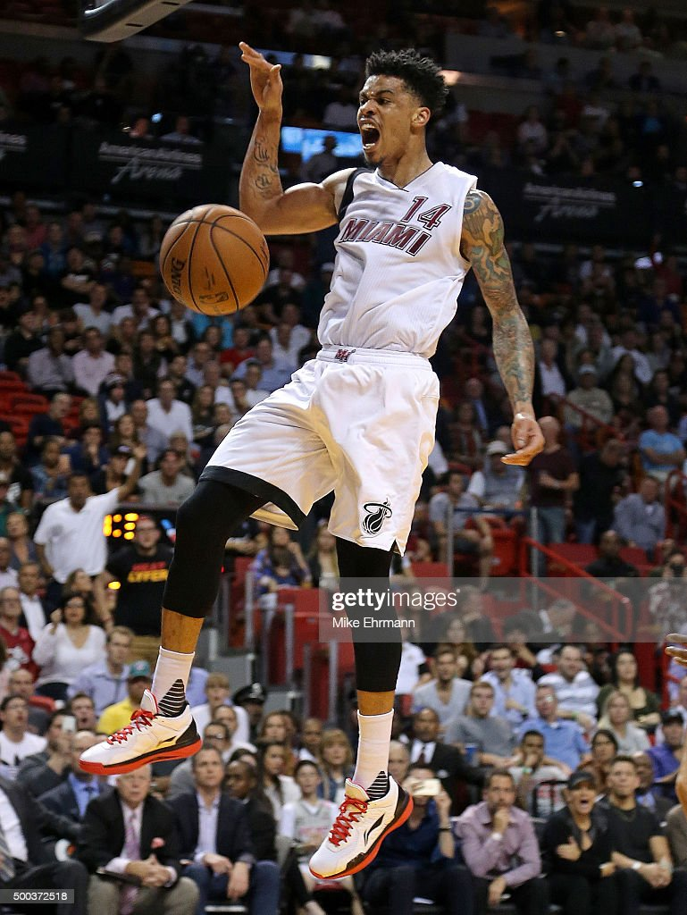 Gerald Green #14 of the Miami Heat dunks during a game against the Washington Wizards at American Airlines Arena on December 7, 2015 in Miami, Florida.