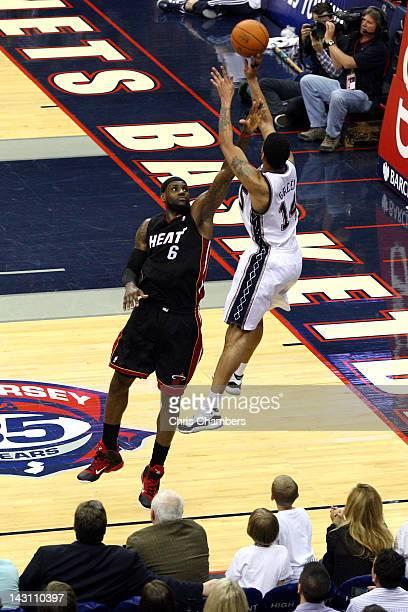 Gerald Green of the New Jersey Nets attempts a shot against LeBron James of the Miami Heat at Prudential Center on April 16 2012 in Newark New Jersey...