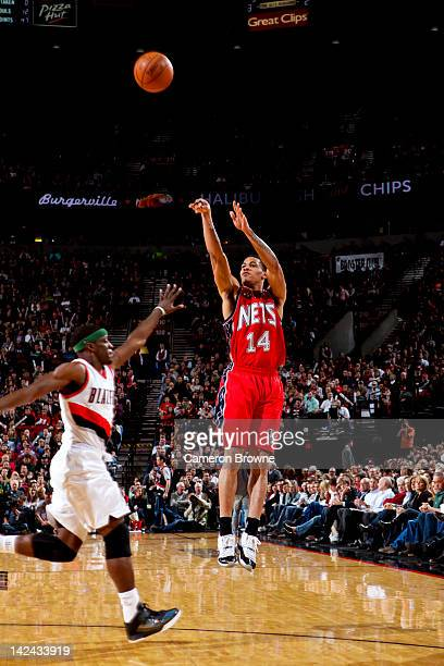 Gerald Green of the New Jersey Nets attempts a threepoint shot against Jonny Flynn of the Portland Trail Blazers on April 4 2012 at the Rose Garden...
