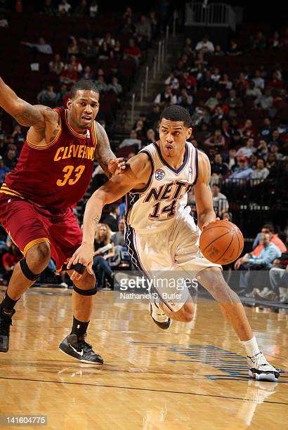Gerald Green of the New Jersey Nets drives to the basket against Alonzo Gee of the Cleveland Cavaliers during the game on March 19 2012 at the...