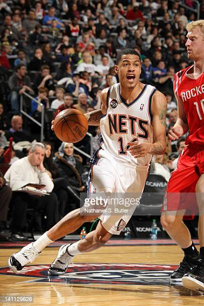 Gerald Green of the New Jersey Nets drives to the basket against Chase Budinger of the Houston Rockets on March 10 2012 at the Prudential Center in...