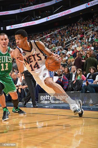Gerald Green of the New Jersey Nets drives to the basket against Aleksandar Pavlovic of the Boston Celtics on April 14 2012 at the Prudential Center...