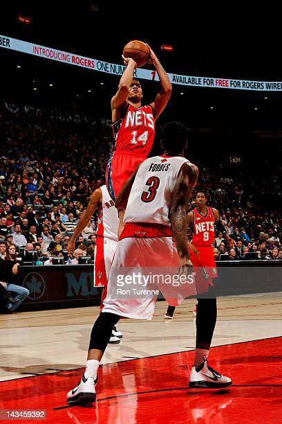 Gerald Green of the New Jersey Nets shoots against Gary Forbes of the Toronto Raptors on April 26 2012 at the Air Canada Centre in Toronto Ontario...