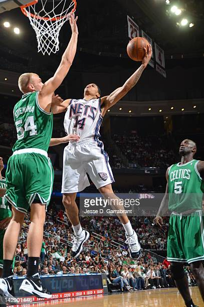 Gerald Green of the New Jersey Nets shoots against Greg Stiemsma of the Boston Celtics on April 14 2012 at the Prudential Center in Newark New Jersey...