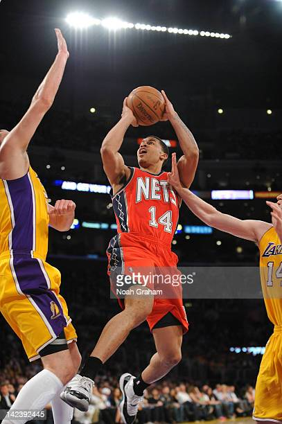 Gerald Green of the New Jersey Nets shoots against Josh McRoberts of the Los Angeles Lakers at Staples Center on April 3 2012 in Los Angeles...