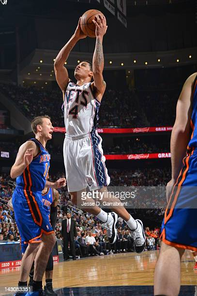 Gerald Green of the New Jersey Nets shoots against Steve Novak of the New York Knicks on April 18 2012 at the Prudential Center in Newark New Jersey...
