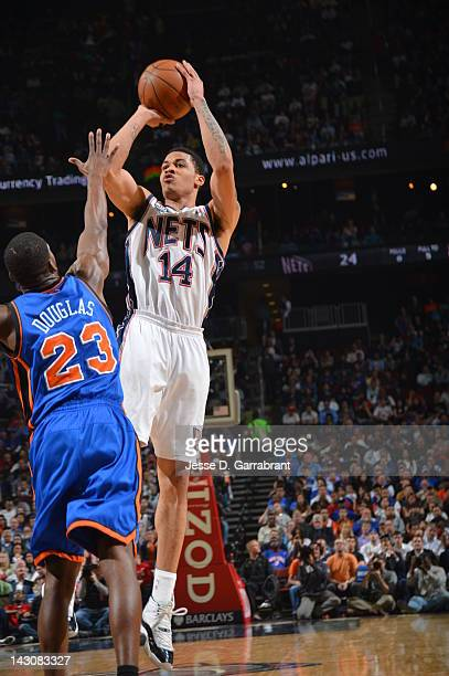 Gerald Green of the New Jersey Nets shoots against Toney Douglas of the New York Knicks on April 18 2012 at the Prudential Center in Newark New...