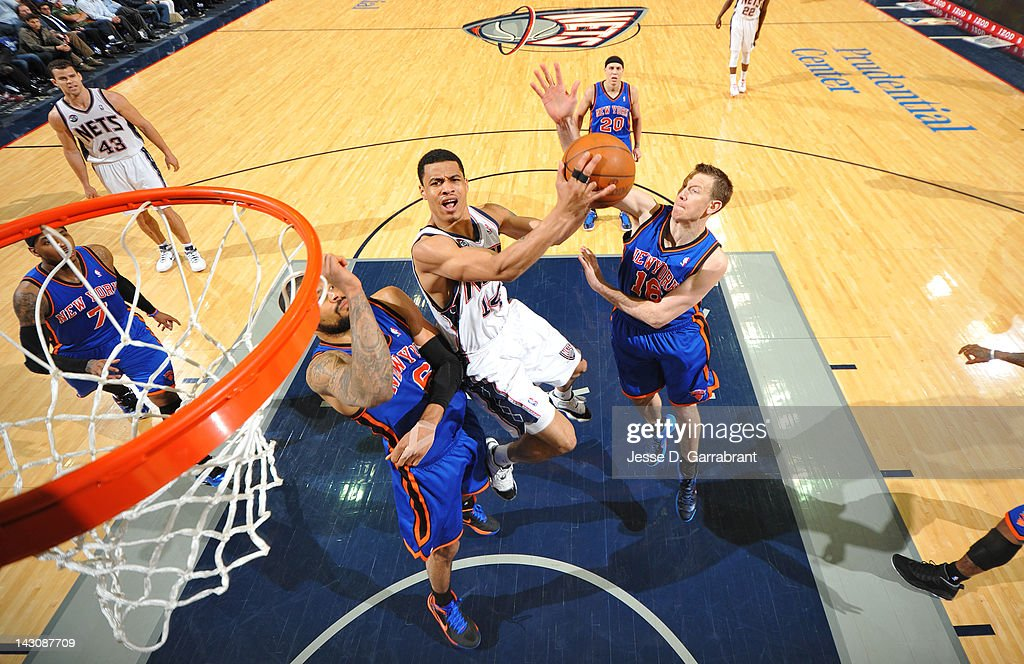 <a gi-track='captionPersonalityLinkClicked' href=/galleries/search?phrase=Gerald+Green&family=editorial&specificpeople=644655 ng-click='$event.stopPropagation()'>Gerald Green</a> #14 of the New Jersey Nets shoots against <a gi-track='captionPersonalityLinkClicked' href=/galleries/search?phrase=Tyson+Chandler&family=editorial&specificpeople=202061 ng-click='$event.stopPropagation()'>Tyson Chandler</a> #6 and <a gi-track='captionPersonalityLinkClicked' href=/galleries/search?phrase=Steve+Novak&family=editorial&specificpeople=693015 ng-click='$event.stopPropagation()'>Steve Novak</a> #16 of the New York Knicks on April 18, 2012 at the Prudential Center in Newark, New Jersey.