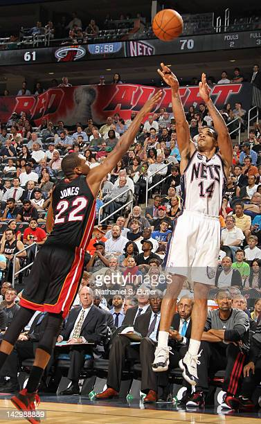 Gerald Green of the New Jersey Nets takes a jump shot over James Jones of the Miami Heat during the game on April 16 2012 at the Prudential Center in...