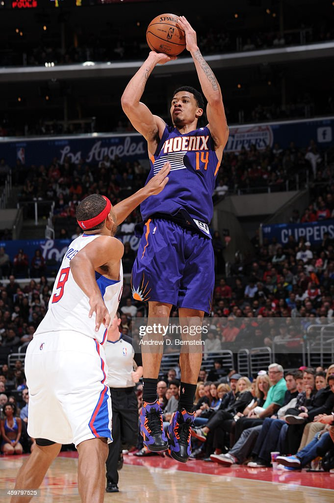 <a gi-track='captionPersonalityLinkClicked' href=/galleries/search?phrase=Gerald+Green&family=editorial&specificpeople=644655 ng-click='$event.stopPropagation()'>Gerald Green</a> #14 of the Phoenix Suns attempts a shot against Jared Dudley #9 of the Los Angeles Clippers at STAPLES Center on December 30, 2013 in Los Angeles, California.