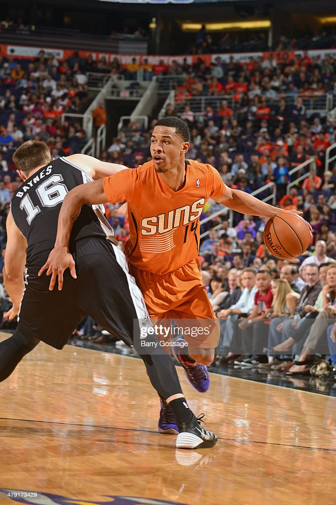 <a gi-track='captionPersonalityLinkClicked' href=/galleries/search?phrase=Gerald+Green&family=editorial&specificpeople=644655 ng-click='$event.stopPropagation()'>Gerald Green</a> #14 of the Phoenix Suns dribbles the ball against the San Antonio Spurs on February 21, 2014 at U.S. Airways Center in Phoenix, Arizona.