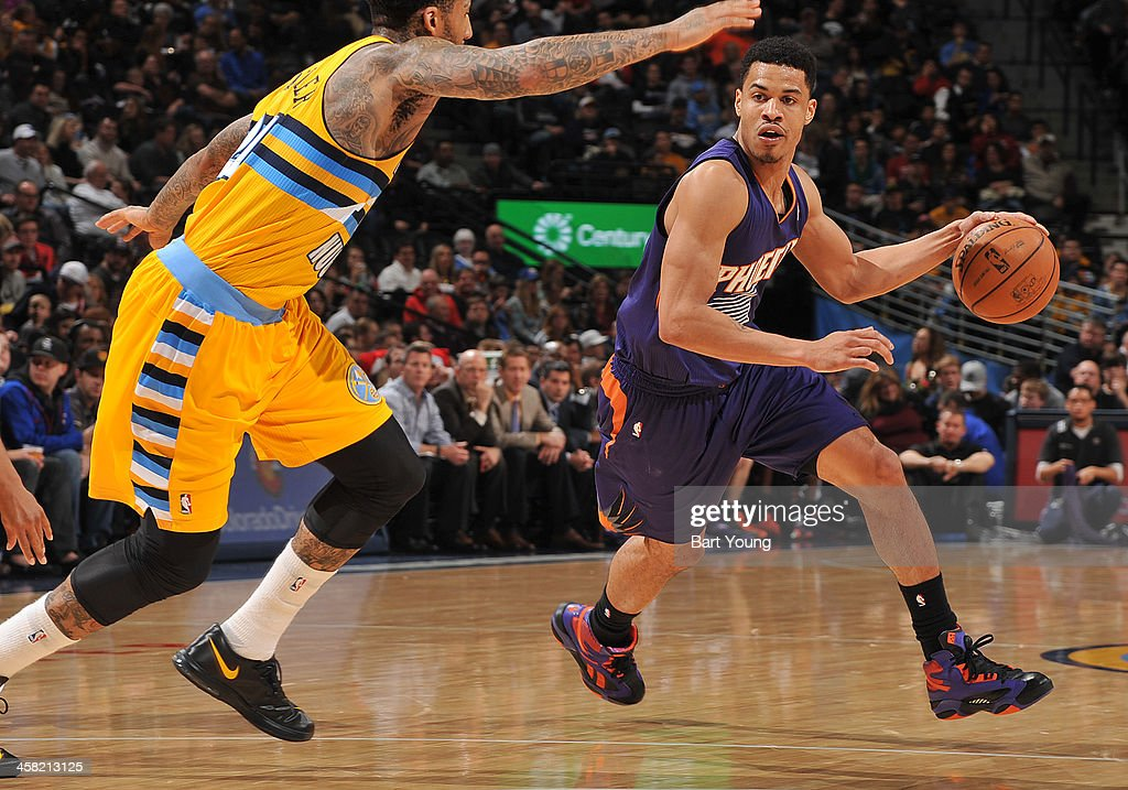 <a gi-track='captionPersonalityLinkClicked' href=/galleries/search?phrase=Gerald+Green&family=editorial&specificpeople=644655 ng-click='$event.stopPropagation()'>Gerald Green</a> #14 of the Phoenix Suns drives to the basket against the Denver Nuggets on December 20, 2013 at the Pepsi Center in Denver, Colorado.