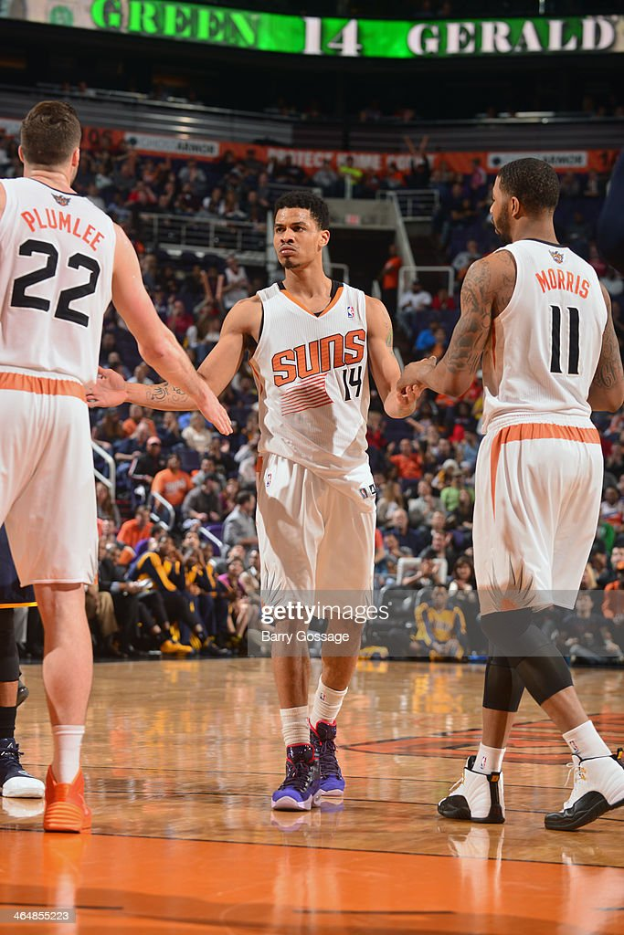 <a gi-track='captionPersonalityLinkClicked' href=/galleries/search?phrase=Gerald+Green&family=editorial&specificpeople=644655 ng-click='$event.stopPropagation()'>Gerald Green</a> #14 of the Phoenix Suns high fives teammates during the game against the Indiana Pacers on January 22, 2014 at U.S. Airways Center in Phoenix, Arizona.