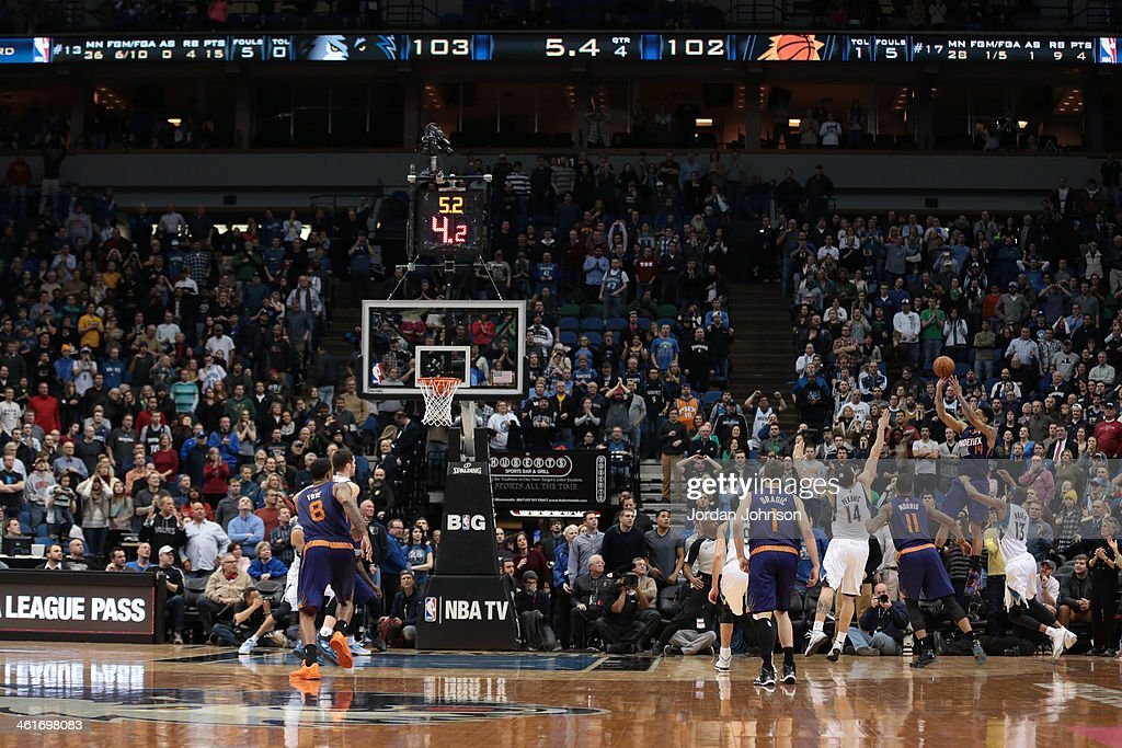 <a gi-track='captionPersonalityLinkClicked' href=/galleries/search?phrase=Gerald+Green&family=editorial&specificpeople=644655 ng-click='$event.stopPropagation()'>Gerald Green</a> #14 of the Phoenix Suns hits the game winning shot against the Minnesota Timberwolves on January 8, 2014 at Target Center in Minneapolis, Minnesota.