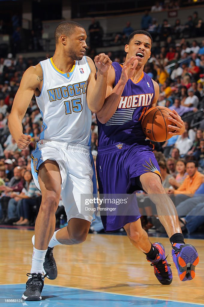 Gerald Green #14 of the Phoenix Suns is fouled by Anthony Randolph #15 of the Denver Nuggets as he drives to the basket during preseason action at Pepsi Center on October 23, 2013 in Denver, Colorado. The Suns defeated the Nuggets 98-79.