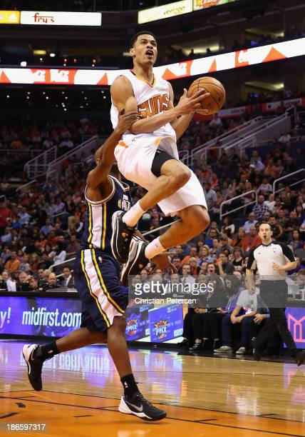 Gerald Green of the Phoenix Suns is fouled by Jamaal Tinsley of the Utah Jazz as he attempts a shot during the first half of the NBA game at US...