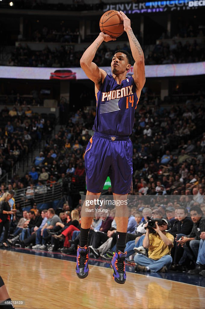<a gi-track='captionPersonalityLinkClicked' href=/galleries/search?phrase=Gerald+Green&family=editorial&specificpeople=644655 ng-click='$event.stopPropagation()'>Gerald Green</a> #14 of the Phoenix Suns shoots the ball against the Denver Nuggets on December 20, 2013 at the Pepsi Center in Denver, Colorado.