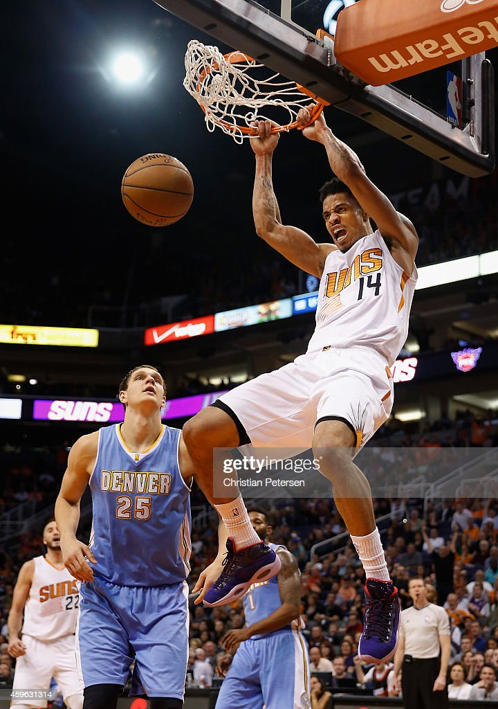 <a gi-track='captionPersonalityLinkClicked' href=/galleries/search?phrase=Gerald+Green&family=editorial&specificpeople=644655 ng-click='$event.stopPropagation()'>Gerald Green</a> #14 of the Phoenix Suns slam dunks the ball over <a gi-track='captionPersonalityLinkClicked' href=/galleries/search?phrase=Timofey+Mozgov&family=editorial&specificpeople=3949705 ng-click='$event.stopPropagation()'>Timofey Mozgov</a> #25 of the Denver Nuggets during the second half of the NBA game at US Airways Center on November 26, 2014 in Phoenix, Arizona. The Suns defeated the Nuggets 120-112.