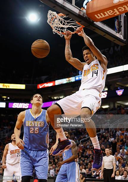 Gerald Green of the Phoenix Suns slam dunks the ball over Timofey Mozgov of the Denver Nuggets during the second half of the NBA game at US Airways...