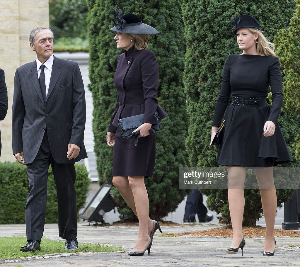 Gerald Grosvenor, Duke Of Westminster and Natalia Grosvenor, Duchess of Westminster (C) with Lady Viola Grosvenor attend a requiem mass for Hugh van Cutsem who passed away on September 2nd 2013 at Brentwood Cathedral on September 11, 2013 in Brentwood, England.