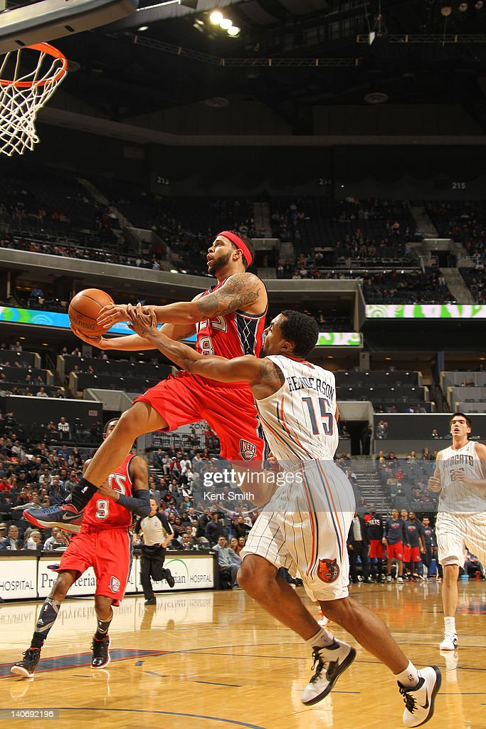 Gerald Henderson #15 of the Charlotte Bobcats attempts to block against <a gi-track='captionPersonalityLinkClicked' href=/galleries/search?phrase=Deron+Williams&family=editorial&specificpeople=203215 ng-click='$event.stopPropagation()'>Deron Williams</a> #8 of the New Jersey Nets during the game at the Time Warner Cable Arena on March 4, 2012 in Charlotte, North Carolina.