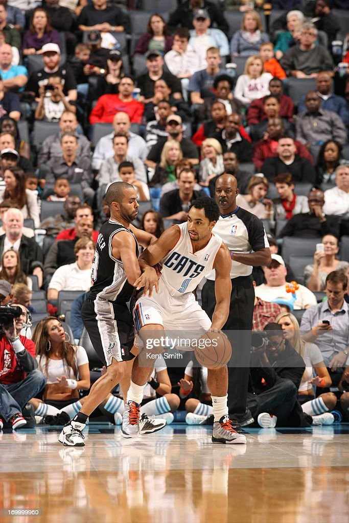 Gerald Henderson #9 of the Charlotte Bobcats backs up to the basket against the San Antonio Spurs at the Time Warner Cable Arena on December 8, 2012 in Charlotte, North Carolina.