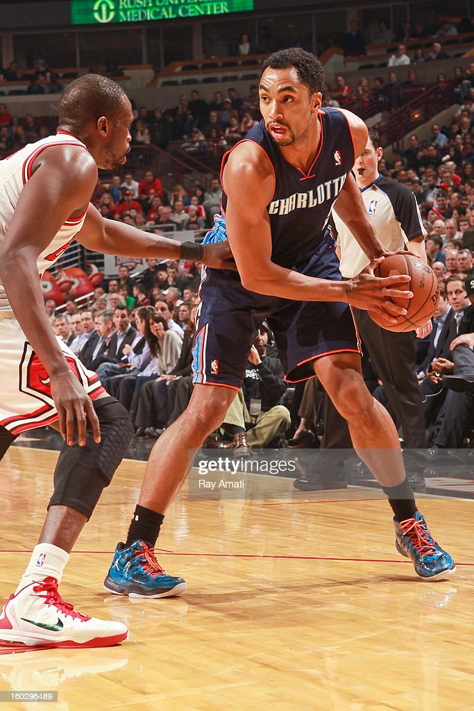 Gerald Henderson #9 of the Charlotte Bobcats controls the ball against Luol Deng #9 of the Chicago Bulls on January 28, 2013 at the United Center in Chicago, Illinois.